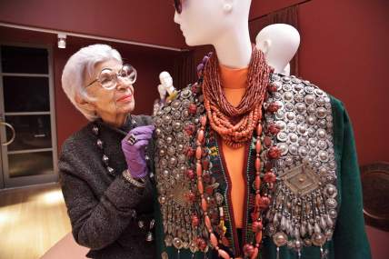 The exhibition about Iris Apfel's style entitled 'Rara Avis (Rare Bird): The Irreverent Iris Apfel' in NYC's Metropolitan Museum of Art was a huge success and therefore travelled to 3 other museums. Here, Iris installs her ensembles at PEM Courtesy Peabody Essex Museum. Notice the ring on top of those rubber gloves (love it!)